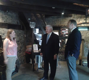 Pennsylvania Governor Tom Corbett, Andy Masich, President and CEO of the Senator John Heinz History Center and Curator, Emily Weaver.