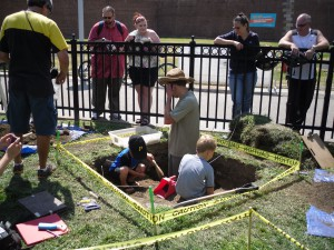 Visitors of the Block House get their hands dirty as they assist in the archaeological dig.  Photo credit: Fort Pitt Society